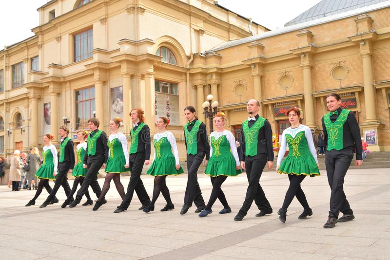 Group of people in national costumes are dancing Irish dances. stock photo