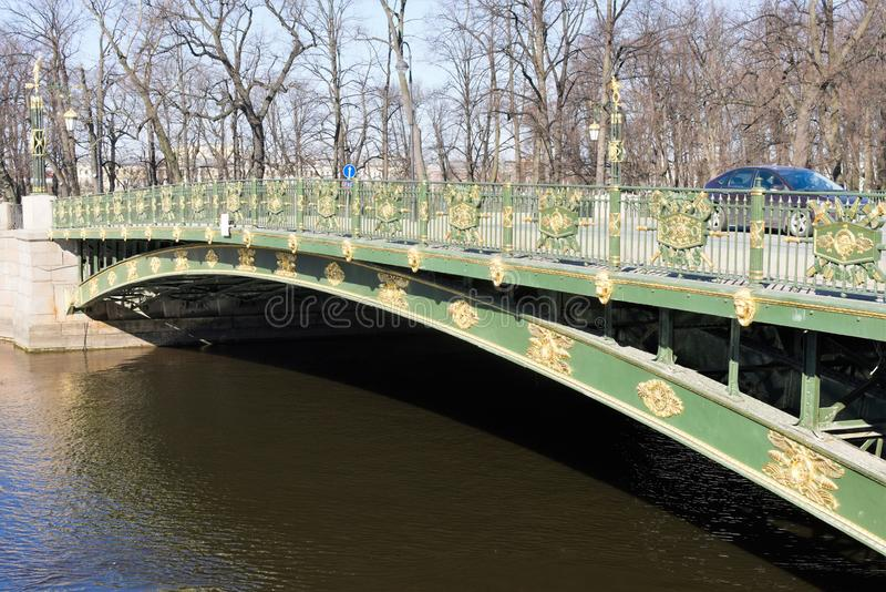 St. Petersburg, Russia, April 2019. Metal bridge over a canal in the center of the city. royalty free stock image
