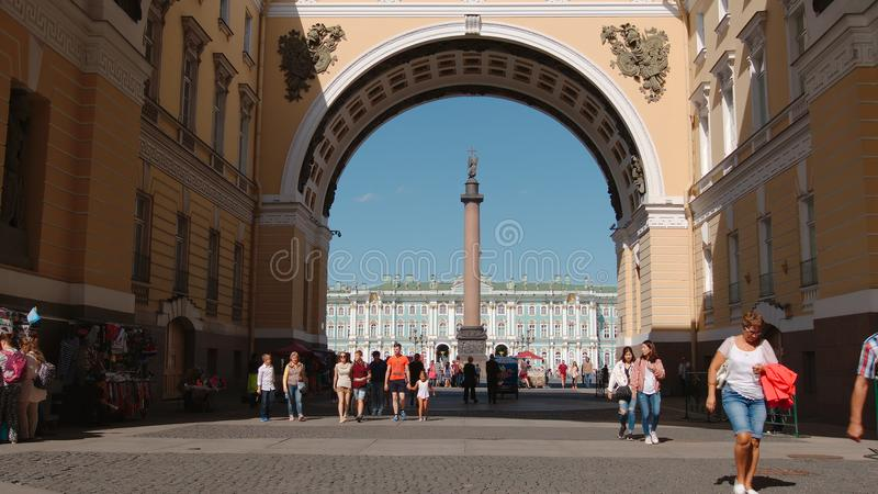 Alexander column through Arch of General staff building and tourists in the summer royalty free stock image