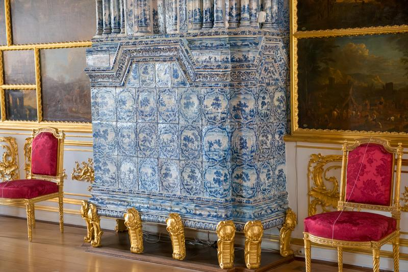 Detail of a fireplace with tiles. ST.PETERSBURG, RUSSIA - AUGUST 19, 2017: A fragment of the Picture hall of the Catherine Palace. Tsarskoe Selo Pushkin, St royalty free stock images