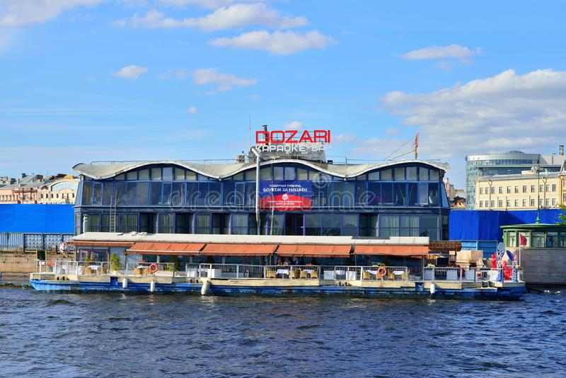 Karaoke Bar Dozari on the embankment of the river Neva stock photography