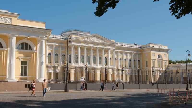 People walk on The Russian Museum background in the summer stock photos