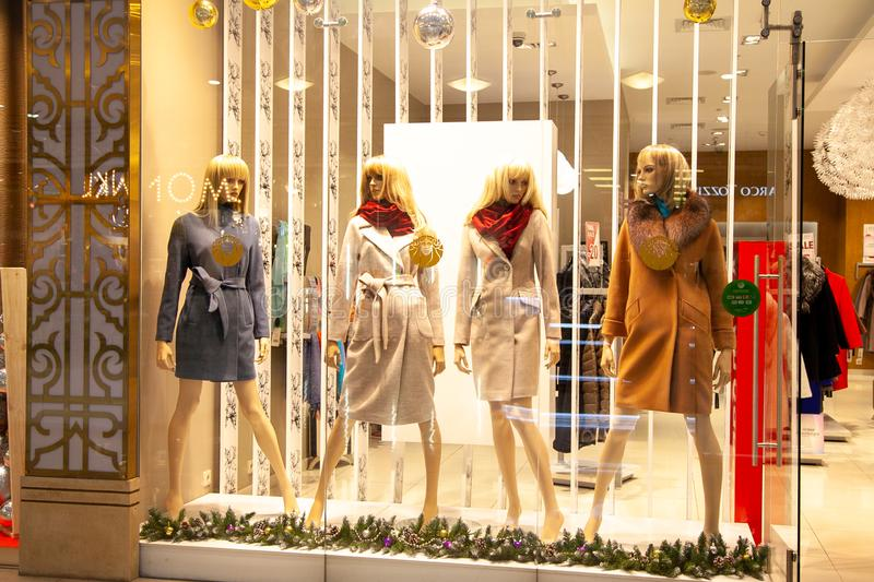 ST. PETERSBURG, RUSSIA - dec 12, 2018: Mannequins Standing In Store Window Display Of Women's Casual fashion Clothing Shop In royalty free stock photo