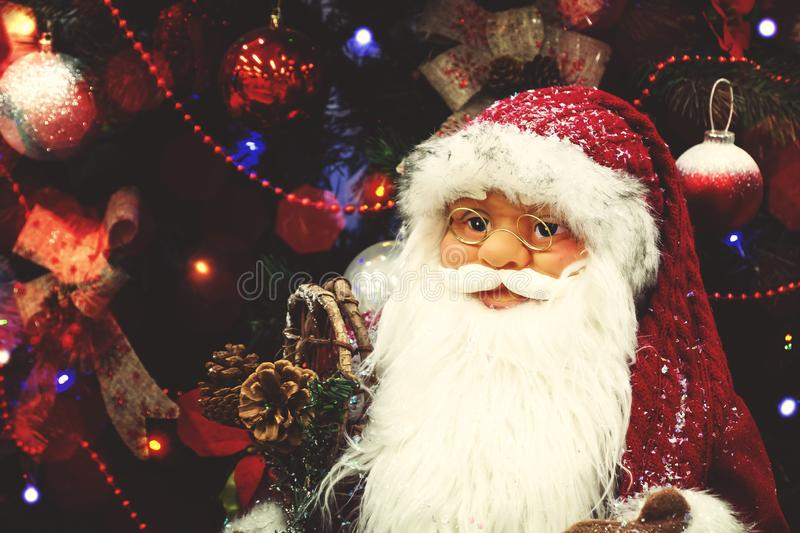 St. Petersburg, Russia - December 25, 2019: Santa Claus puppet on the background of a beautifully decorated Christmas stock images