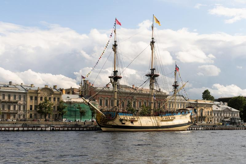 St. Petersburg, Russia, July 2019. Restored three-masted brig against the background of the urban landscape. The first self-built Russian large ship of the line stock images