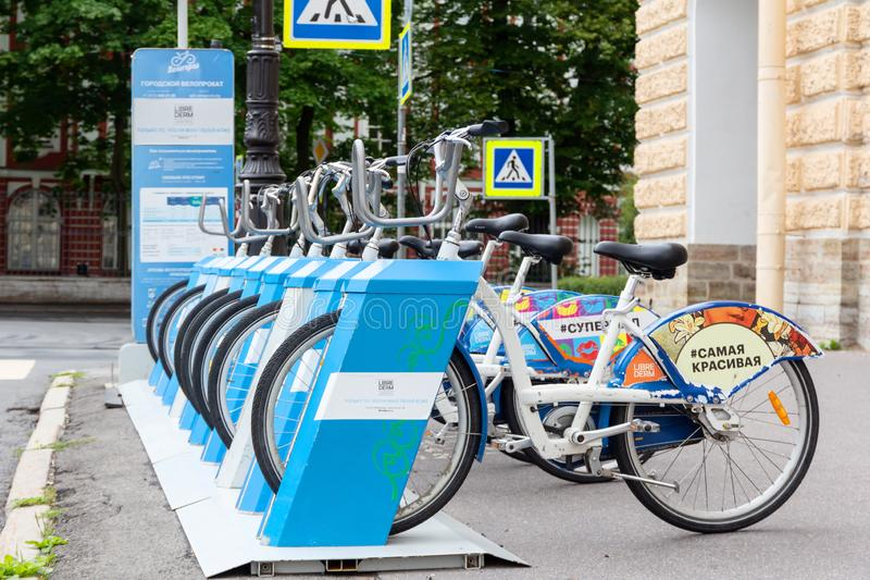 Row of rental bikes self-service and bike exchange scheme for trips around St. Petersburg royalty free stock images