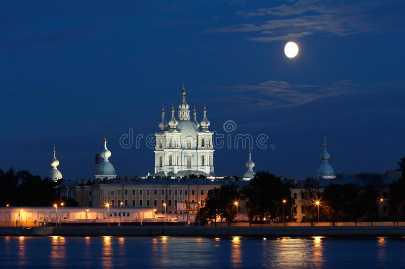 Smolny Cathedral and a Moon in White Nights stock images