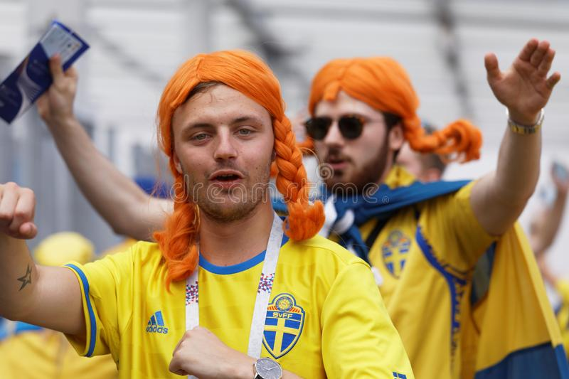 Swedish football fans in Saint Petersburg, Russia during FIFA World Cup 2018. St. Petersburg, Russia - July 3, 2018: Swedish football fans at Saint Petersburg stock photos