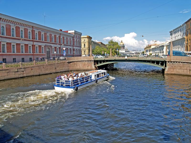 ST. PETERSBURG, RUSSIA. The tourist boat on the Moika River royalty free stock photography