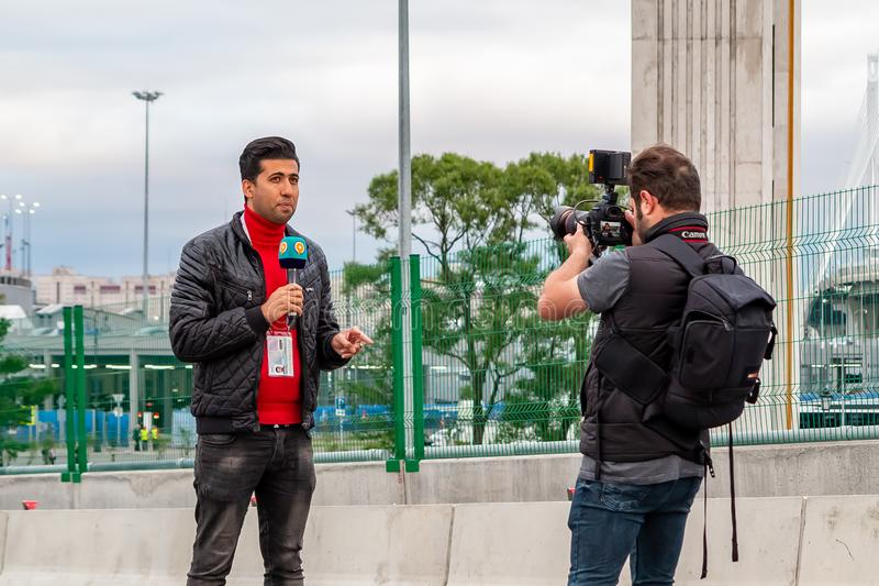 St. Petersburg, Russia - July 10, 2018: TV Reporters are reporting live from the Yacht Bridge before the football match in St. stock photos