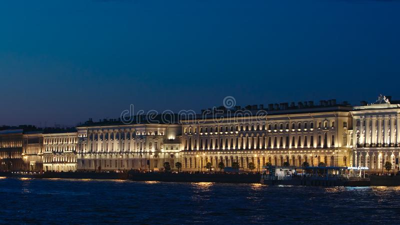 Illuminated palaces on an embankment of the Neva river in the White Nights. ST. PETERSBURG, RUSSIA - JUNE 18, 2017: Illuminated palaces on an embankment of the stock photo