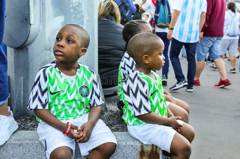 St. Petersburg, Russia - June 26, 2018: Young fans of Nigeria national football team. royalty free stock photo