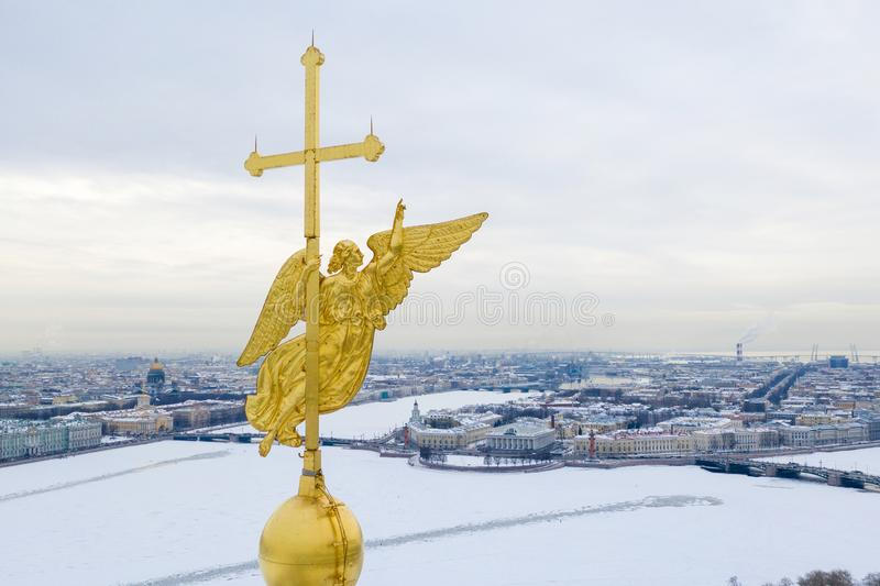 ST. PETERSBURG, RUSSIA - MARCH, 2019: Beautiful aerial view on the center of winter Saint Petersburg city through the Angel of. Peter and Paul Cathedral stock photo