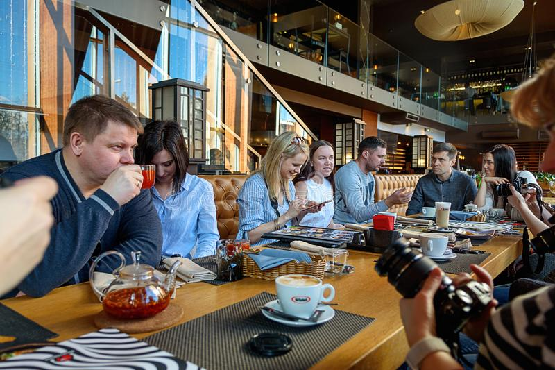 St. Petersburg, Russia-March 24, 2019. A group of four business people gathered at the Breakfast table, discussing an interesting royalty free stock photo