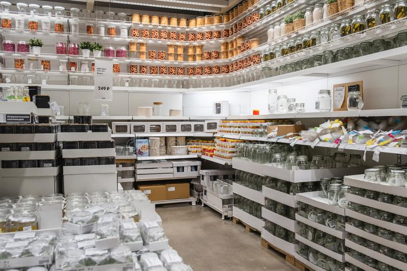 ST. PETERSBURG, RUSSIA - MARCH, 2019: Interior of elegant IKEA furniture store with tableware objects and other home decorations. And other kitchen utensils royalty free stock photo