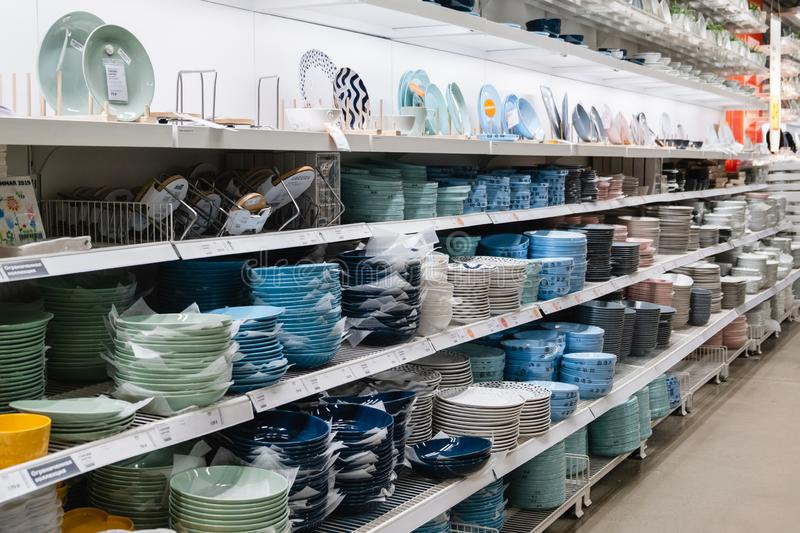 ST. PETERSBURG, RUSSIA - MARCH, 2019: Interior of elegant IKEA furniture store with tableware objects and other home decorations. And other kitchen utensils royalty free stock images