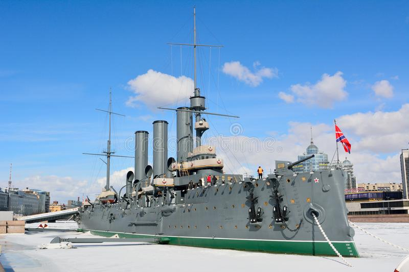 Russian cruiser Aurora in St Petersburg. St Petersburg, Russia - March 27, 2018. Russian cruiser Aurora, dating from 1900, in St Petersburg, with people royalty free stock photos