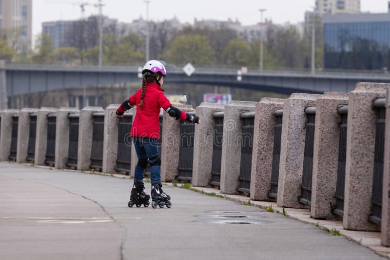 Girl rollerblading stock images