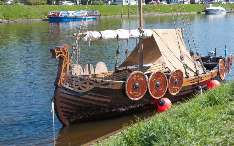St. Petersburg, Russia - May 27, 2017: Moored small Viking ship in St. Petersburg, Russia. Moored small Viking ship in St. Petersburg, Russia stock photo