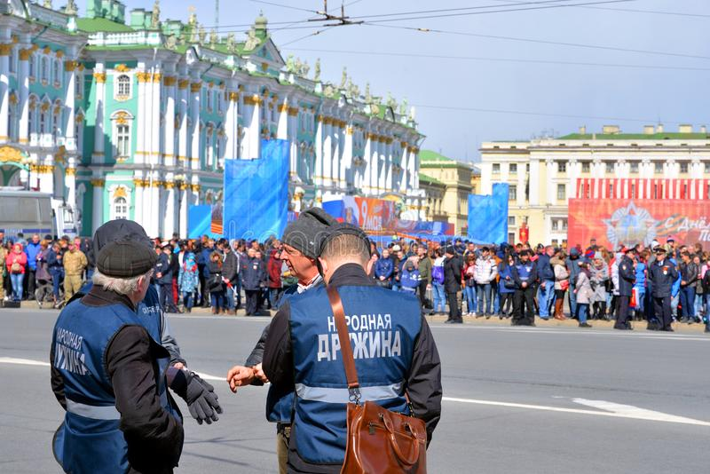 Russian people`s squad. ST.PETERSBURG, RUSSIA: - MAY 9, 2017: Russian people`s squad on the city street of Saint Petersburg. View from the back stock images