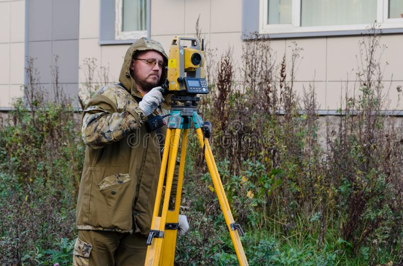 St. Petersburg,Russia-October 23,2018 -surveyor worker with theodolite stock photo