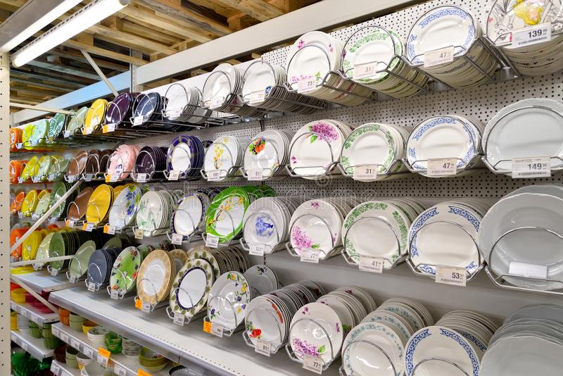White and color plates on a trade counter in the hypermarket Car royalty free stock photo