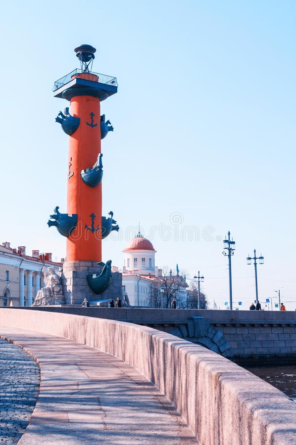 St Petersburg, Russia. Rostral column and custom building - landmarks of the Vasilievsky island spit in spring day royalty free stock image