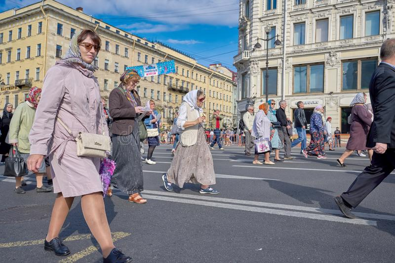 ST PETERSBURG, RUSSIA - September 12, 2019: Religious procession, old women carry icons on Nevsky Prospekt in St. Petersburg. ST PETERSBURG, RUSSIA - September stock image