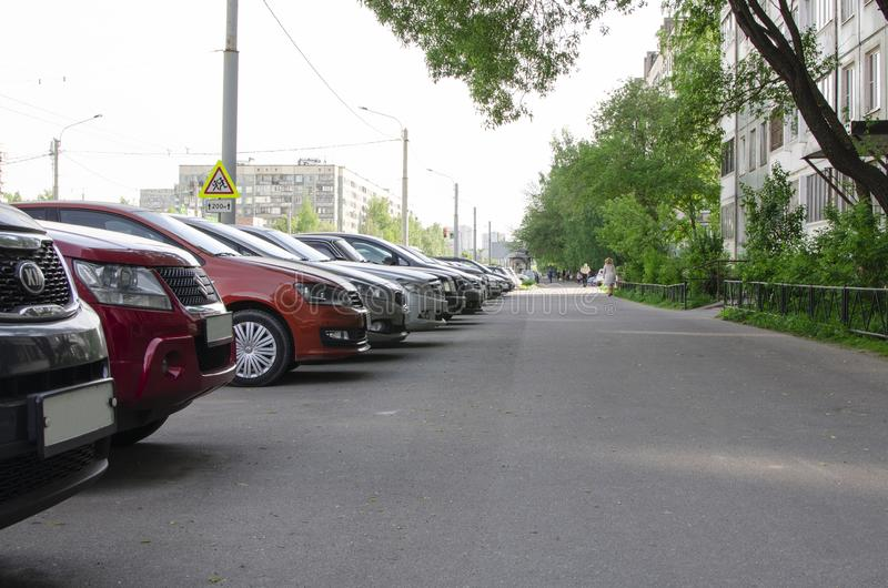 St. Petersburg / Russia - May 2019: street in summer. A number of cars standing at high-rise houses. stock photography