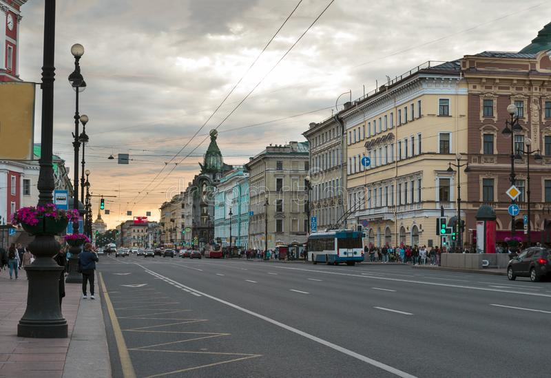 St. Petersburg street at sunset, Nevsky prospect. Buildings, people on the street ,road, sky with clouds royalty free stock photography
