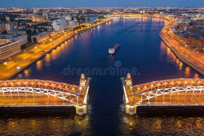 St. Petersburg, white nights, divorced Bolsheokhtinsky bridge, the passage of ships along the Neva.  stock photography