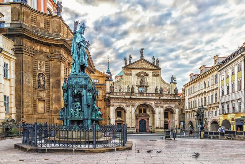 St Salvator Church and St Francis of Assisi Church near the monument to King Charles IV in Prague stock images