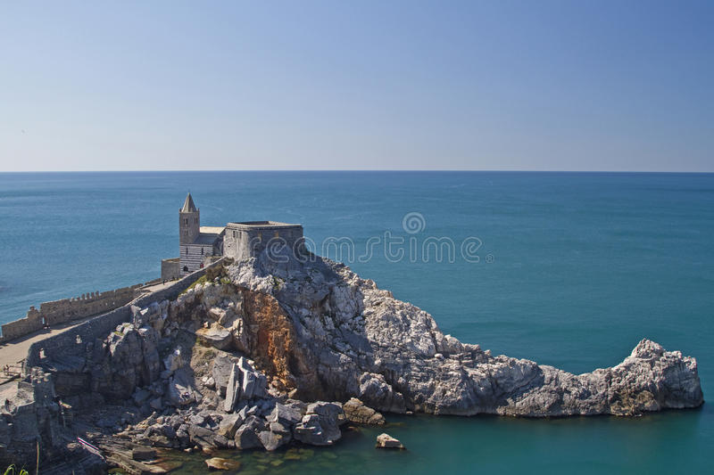 St. Simon in Portovenere. St Simon - The picturesque old church in the Gothic style, stands on jagged cliffs near Portovenere royalty free stock image