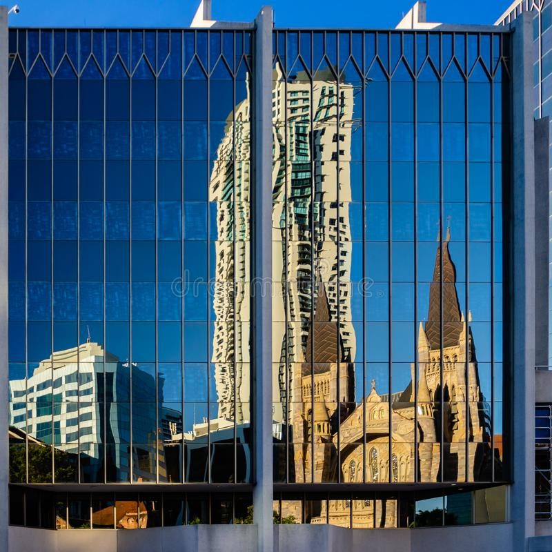 St Stepehens Cathedral reflected in a Brisbane CDB building stock images
