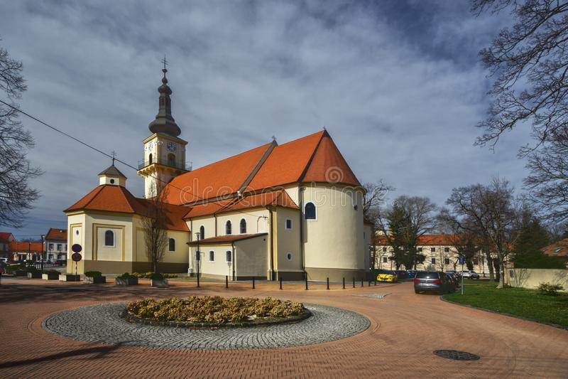 St. Stephen church at Stupava. Built in 14th century at Namestie Svatej Trojice square during spring, Europe, Slovakia royalty free stock photo