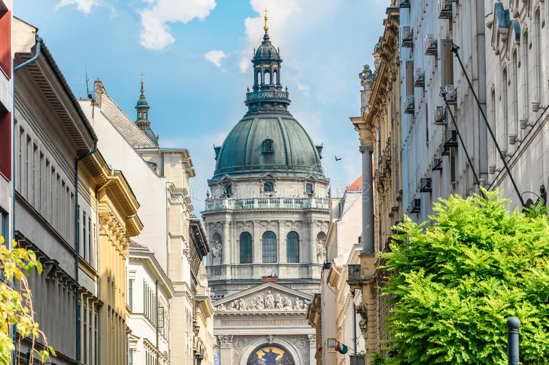 St.Stephen`s Basilica Szent Istvan Bazilika. Budapest, Hungary. St.Stephen`s Basilica Szent Istvan Bazilika. Blue cloudy sky. Two bell towers with the clocks stock images