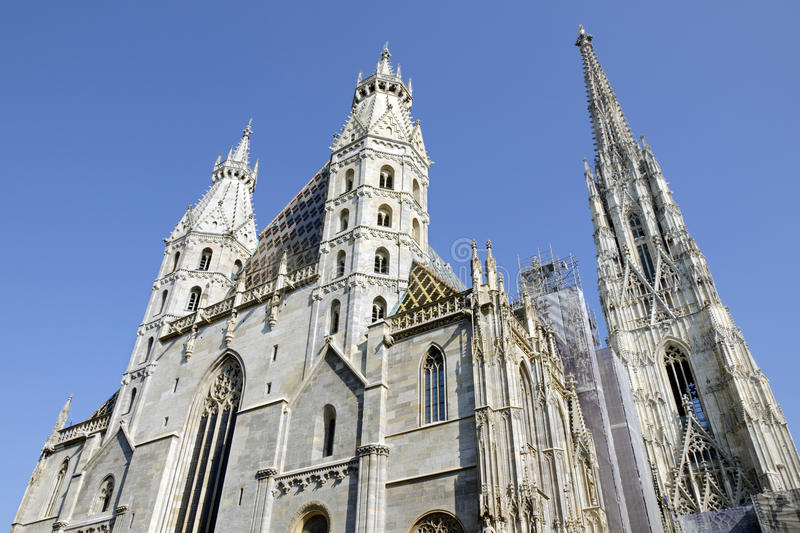 St. Stephen's Cathedral, Vienna, Austria. St. Stephen's Cathedral, Vienna, the view of two Romanesque Towers on the west front and the 136 metres (446 ft) tall stock photos