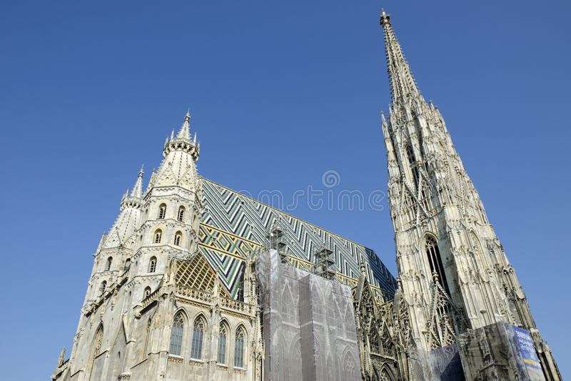 St. Stephen's Cathedral, Vienna, Austria. St. Stephen's Cathedral, Vienna, the view of two Romanesque Towers on the west front and the 136 metres (446 ft) tall royalty free stock photography