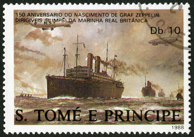 ST. THOMAS AND PRINCE ISLANDS - 1988: Dirigibles flying over British merchant ships, Ferdinand Graf Von Zeppelin 1838-1917. ST. THOMAS AND PRINCE ISLANDS - CIRCA royalty free stock image