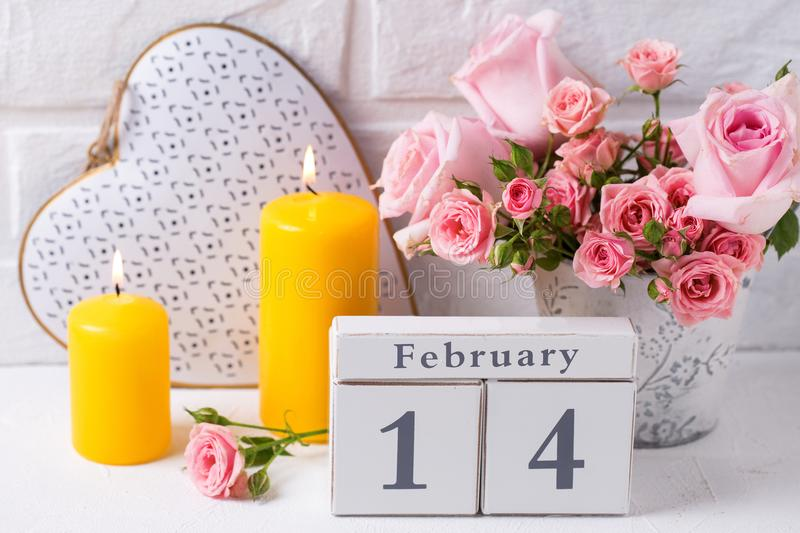 Pink roses flowers, calendar, decorative heart and yellow ca royalty free stock photography