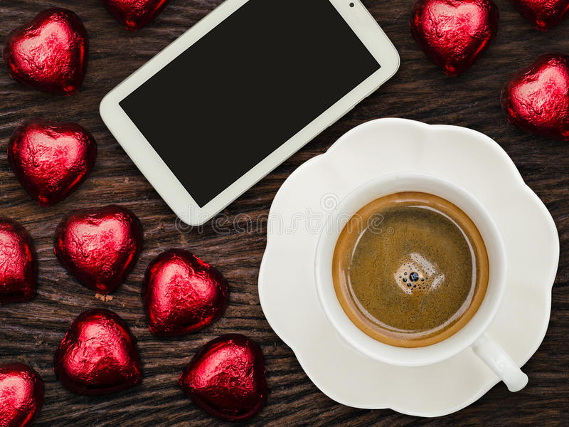 St Valentine's breakfast with coffee and chocolate. On wood table stock photos