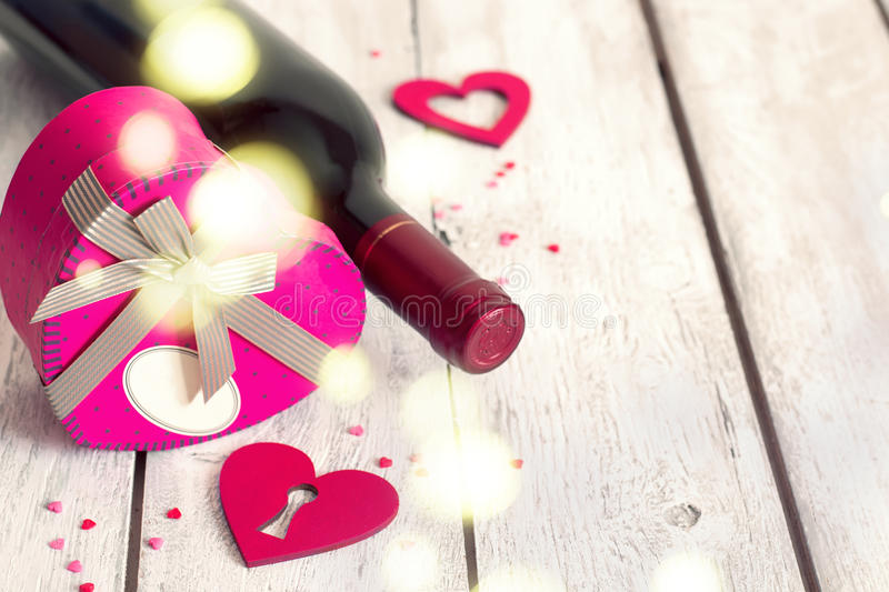 St. Valentine`s day background with heart gift and red wine stock photos