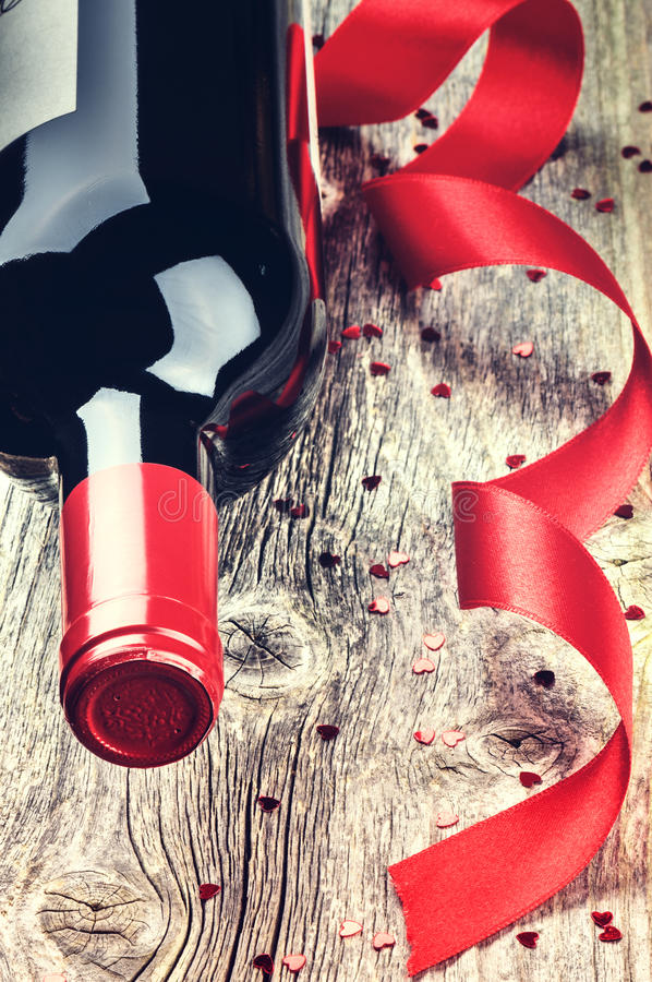 St Valentine's setting with bottle of red wine stock image