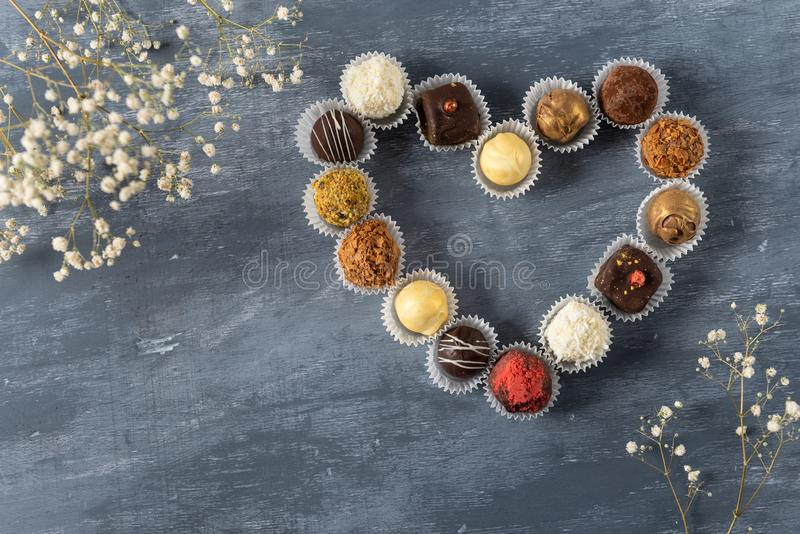 St. Valentines Day card background. Chocolate candies in heart shape. Copy space, top view stock photo