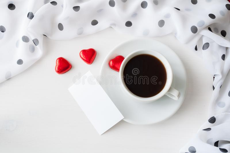 St Valentines day romantic background - cup of coffee, heart shaped candies and blank card for romantic message stock images