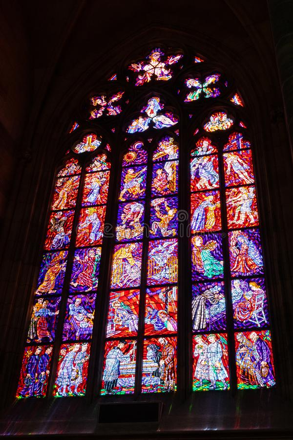 Stained glass window in Chapel of the Holy Sepulchre, in St Vitus Cathedral, in Prague royalty free stock photo
