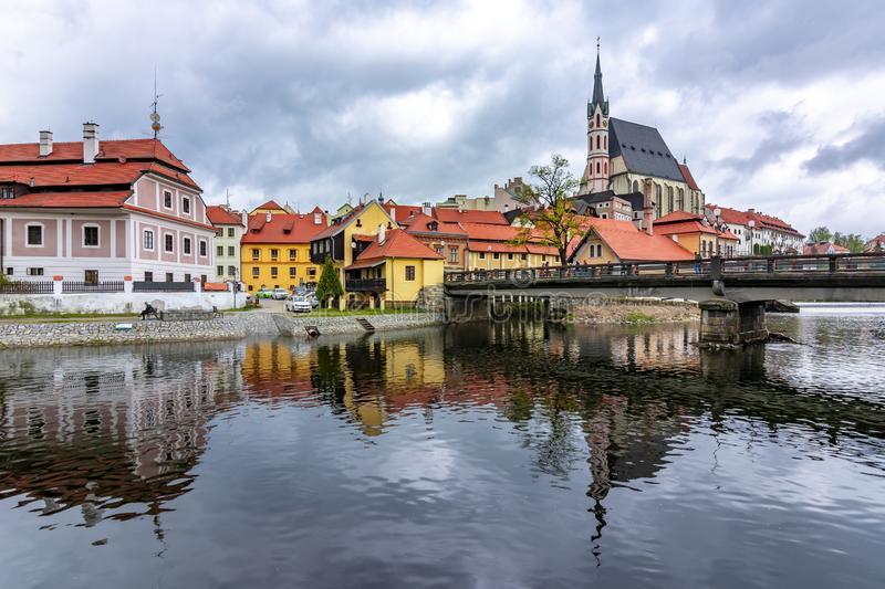 St. Vitus Church and Cesky Krumlov architecture reflected in Vltava river, Czech Republic royalty free stock photo