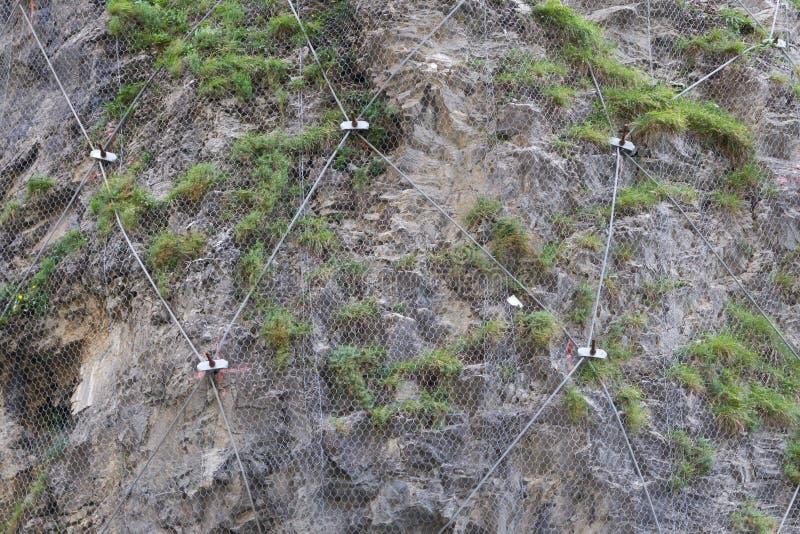 Staal netto voor bescherming tegen rotsdia stock foto