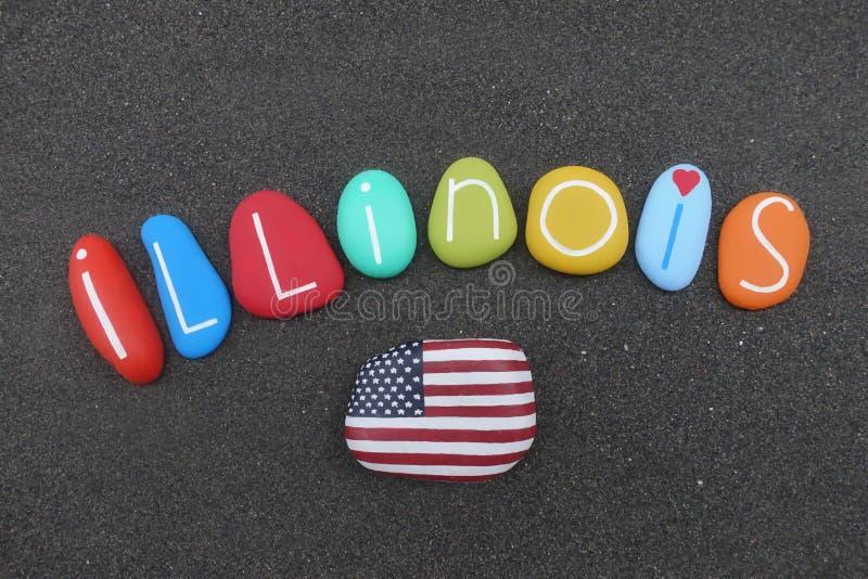 Staat Illinois in Vereinigten Staaten, Andenken mit multi farbigen Seesteinen über schwarzem vulkanischem Sand mit USA-Flagge stockbild