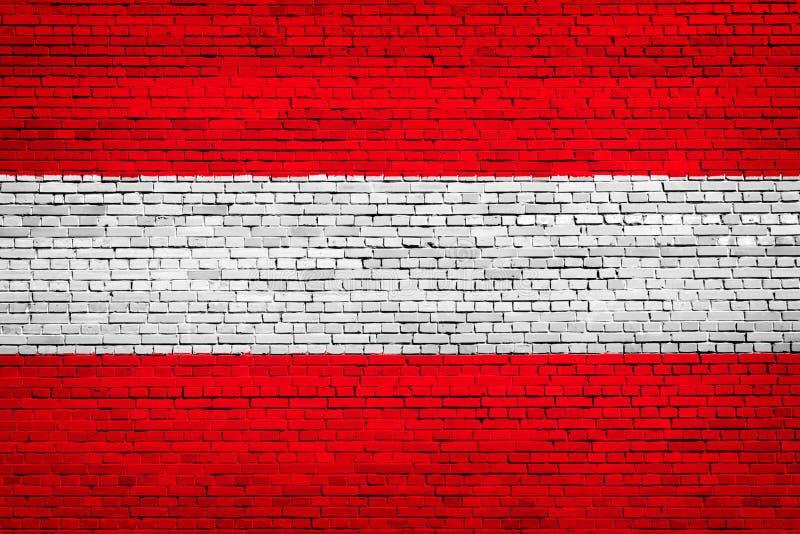 Staatsflagge von Österreich auf einem Ziegelstein lizenzfreie abbildung